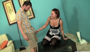 Irresistible redhead maid in stockings Jamey James rides a smarting stick