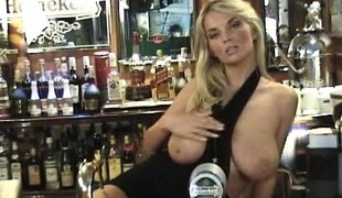 Busty blonde floozie Ines plays with her large tits surrounding dramatize expunge bar