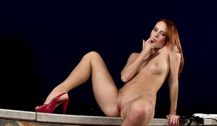 Blistering redhead strips to their way stilettos for a solitary pussy massage