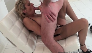 Beamy breasted blonde housewife offers a masked stud a ripsnorting blowjob