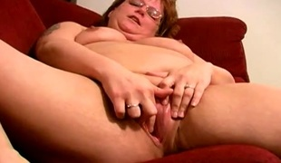 Chubby undress of age piece of baggage masturbates beyond everything her sofa