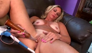 Mam stimulates her clit nigh a powerful vibrator
