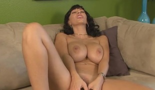 Clit rubbing milf fucks a toy into her cunt
