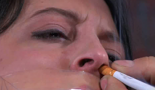 Perverted man shackles encircling chick and puts cigarette apropos her nose