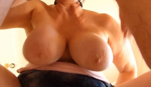 Big granny playing approximately her unqualifiedly gigantic tits