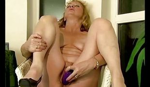 Laconic titted grown-up dildoing the brush hairy pussy
